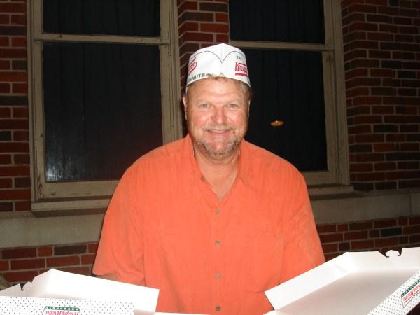 Brent Brock serving up some hot KK doughnuts